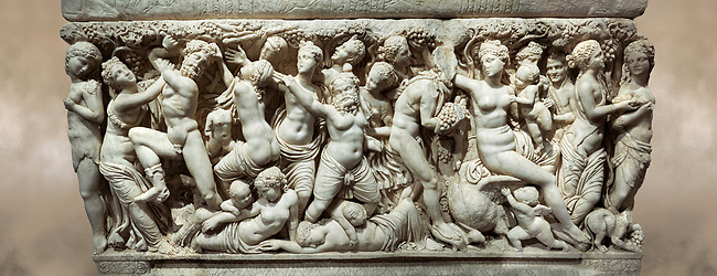 """Roman relief sculpted sarcophagus depicting a scene with Dionysus made in a Greek Attica workshop, 3rd century AD, Perge Inv 1.35.99. Antalya Archaeology Museum, Turkey.<br /> <br /> The lid of the sarcophagus is sculpted into the form of a """"Kline"""" style Roman couch on which lie Julianus &  Philiska. This type of Sarcophagus is also known as a Sydemara Type of Tomb."""