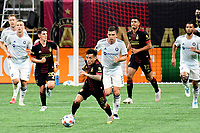 ATLANTA, GA - APRIL 24: Atlanta United midfielder #8 Ezequiel Barco dribbles the ball during a game between Chicago Fire FC and Atlanta United FC at Mercedes-Benz Stadium on April 24, 2021 in Atlanta, Georgia.