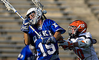 Chris Bocklet (10) of Virginia knocks the ball loose from the stick of  Dan Wigrizer (19) of Duke during the ACC men's lacrosse tournament semifinals in College Park, MD.  Virginia defeated Duke, 16-12.
