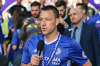 John Terry of Chelsea gets emotional as he addresses the Chelsea supporters after lifting the Premier League Trophy after his last Premier League match following the EPL - Premier League match between Chelsea and Sunderland at Stamford Bridge, London, England on 21 May 2017. Photo by David Horn.