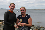 Sue McKinney presents Gillian Kiernan with Ladies 1st Prize at the Green Buoy 1KM Swim in Clogherhead....(Photo credit should read Jenny Matthews/NEWSFILE)...