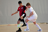Mojtaba Sayed of Selwyn College and Samuel Fowles of Hamilton Boys' High School battle for the ball during the Futsal NZ Secondary Schools Junior Boys Final between Hamilton Boys High School and Selwyn College at ASB Sports Centre, Wellington on 26 March 2021.<br /> Copyright photo: Masanori Udagawa /  www.photosport.nz