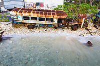 An old bus is inundated by waves from Funafuti lagoon, during the king tides which cause flooding from January through to March in Funafuti, Tuvalu. March, 2019.