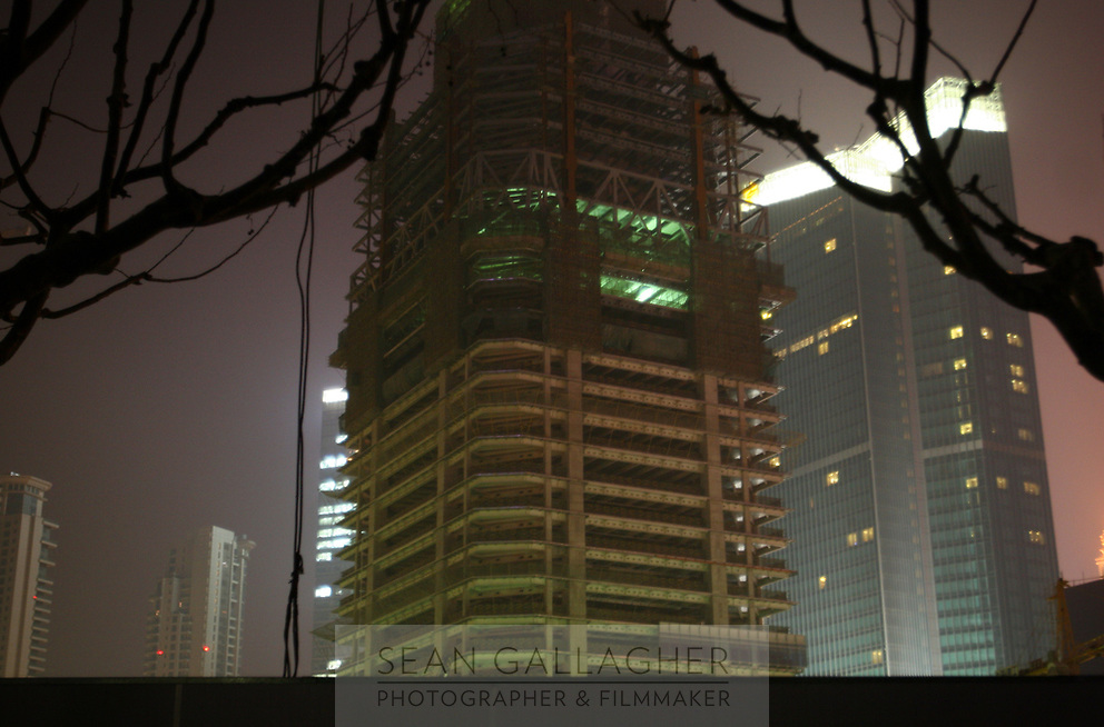 CHINA. Shanghai. A view of skyscrapers being built in Pudong next to the Huangpu river. 2008.