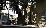 Cyclone Nargis survivor play at a temple turned into a makeshift refugee center at the village of Kamingo in Irrawaddy Division, May 10, 2008. Despairing survivors in Myanmar awaited emergency relief on Friday, a week after 100,000 people were feared killed as the cyclone roared across the farms and villages of the low-lying Irrawaddy delta region. The storm is the most devastating one to hit Asia since 1991, when 143,000 people were killed in neighboring Bangladesh. Photo by Eyal Warshavsky  *** Local Caption *** ëì äæëåéåú ùîåøåú ìàéì åøùáñ÷é àéï ìòùåú áúîåðåú ùéîåù ììà àéùåø