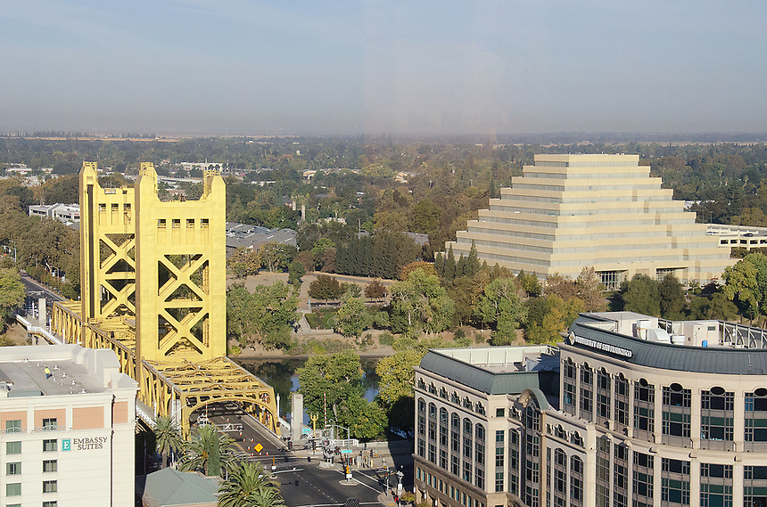 Today's photo entry was from Downtown/Old Sacramento. I brought my camera with me during the day because every time we come home after work, it is very dark outside. Sacramento's Tower Bridge is on the left, and the pyramid shaped building is called the Ziggurat building.