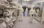 Intel workers wear special clothing as they prepare to manufacture microchips at Intel Corp. headquarters in Santa Clara, Calif., Monday, July 17, 2006. Intel Corp., the world's biggest maker of microchips, is expected to post a second-quarter profit of 13 cents a share on sales of $8.27 billion, the average estimates in a Thomson Financial survey of analysts. (AP Photo/Paul Sakuma)