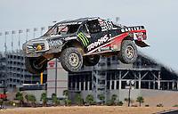 Nov. 6, 2010; Las Vegas, NV USA; LOORRS pro four unlimited driver Rick Huseman takes a jump during round 13 at the Las Vegas Motor Speedway short course. Mandatory Credit: Mark J. Rebilas-