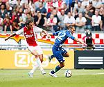 Nederland, Amsterdam, 17 juli 2015<br /> Oefenwedstrijd<br /> Ajax-VFL Wolfsburg<br /> Mitchell Dijks van Ajax en Bas Dost van Wolfsburg strijden om de bal