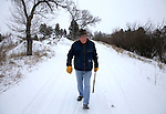 """Ben Henan, 90, walks on a dirt road north of the VA Medical Center Tuesday morning in Cheyenne. Henan was raised in Fort Washakie and served in the United States Marine Corps during World War II. He watched the Battle of the Coral Sea from the deck of his transport ship and was wounded during the Battle of Guadalcanal in 1942. """"Wyoming is the greatest place on earth and I like how the wind blows away the snow here in Cheyenne."""" said Henan. He also attributes his longevity to a daily walk.  To participate in WTE Photo Editor Michael Smith's 2014 Our Faces: Portraits of Laramie County project, call to make an appointment at 633-3124 or 630-8388 or email msmith@wyomingnews.com. Michael Smith/staff"""