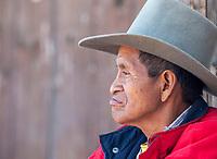 Chichicastenango, Guatemala.  Quiche (Kiche, K'iche') Man Sitting on Steps of Santo Thomas Church, Sunday Morning.