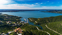 Aerial view of Lake Travis overlooking St. Luke's on the Lake Episcopal Church and the Marshall Ford Marina. Lake Travis is a reservoir on the Colorado River in Austin, Texas. The reservoir was formed in 1942 by the construction of Mansfield Dam on the western edge of Austin by the Lower Colorado River Authority, and was built specifically to contain floodwaters in a flash-flood prone Highland Lakes.
