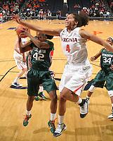 Jan. 6, 2011; Charlottesville, VA, USA; Miami Hurricanes guard Shenise Johnson (42) grabs the rebound in front of Virginia Cavaliers center Simone Egwu (4) during the game at the John Paul Jones Arena. Miami won 82-73. Mandatory Credit: Andrew Shurtleff