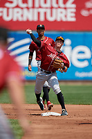 Altoona Curve second baseman Mitchell Tolman (19) throws to first base as shortstop Alfredo Reyes (13) backs up the play during an Eastern League game against the Erie SeaWolves and on June 4, 2019 at UPMC Park in Erie, Pennsylvania.  Altoona defeated Erie 3-0.  (Mike Janes/Four Seam Images)