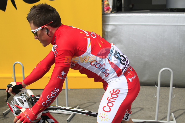 Samuel Dumoulin (FRA) Cofidis at sign on before the start of Stage 1 of the 99th edition of the Tour de France, running 198km from Liege to Seraing starting in Parc d'Avroy Liege, Belgium. 1st July 2012.<br /> (Photo by Eoin Clarke/NEWSFILE)