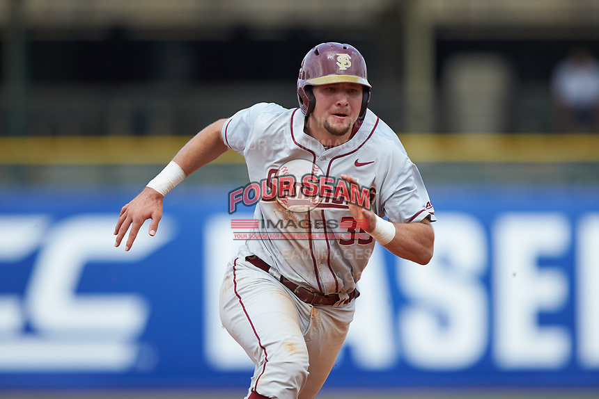 Cal Raleigh (35) of the Florida State Seminoles hustles towards third base against the Louisville Cardinals in Game Eleven of the 2017 ACC Baseball Championship at Louisville Slugger Field on May 26, 2017 in Louisville, Kentucky. The Seminoles defeated the Cardinals 6-2. (Brian Westerholt/Four Seam Images)