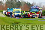 Firemen working to free a motorist at the scene of the crash on the Killarney-Farranfore road on Tuesday morning