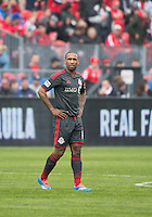 Toronto, Ontario - May 3, 2014: Toronto FC forward Jermain Defoe #18 in action during a game between the New England Revolution and Toronto FC at BMO Field.<br /> The New England Revolution won 2-1.