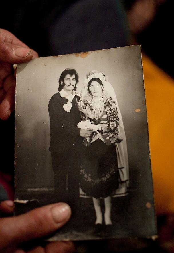 Kolarovo, Bulgaria, Kalaidzhi --Anka Koleva, 72, holds a photo from her daughter Ivanova Ivanova's wedding to Vasil Kolev. Most Kalaidzhi believe in marrying only inside their caste and maintaining the traditional craft of tin-smithing and gender roles.