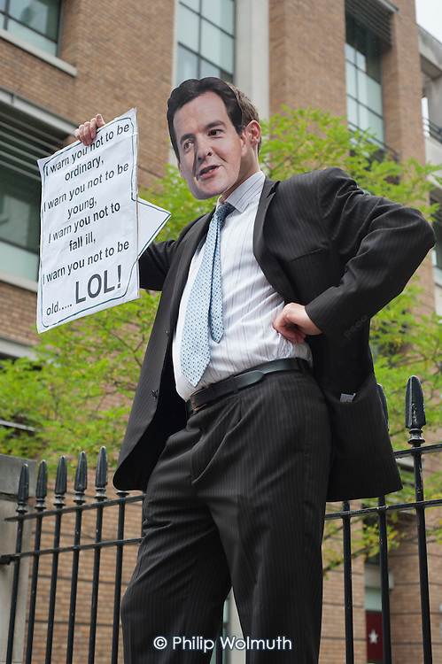 Man wearing a George Osborne mask.  End Austerity Now, national demonstration organised by the People's Assembly, London.
