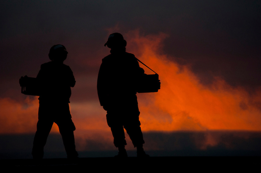 101215-N-7981E-534 PACIFIC OCEAN (Dec. 15, 2010)- Sailors assigned to Air Department's V-2 Division stand by to display the weights of aircraft being launched from one of four steam-powered catapults at dusk on the flight deck of USS Carl Vinson (CVN 70). Carl Vinson and Carrier Air Wing (CVW) 17 are currently on a three-week composite training unit exercise (COMPTUEX) followed by a western Pacific deployment. (U.S. Navy photo by Mass Communication Specialist 2nd Class James R. Evans / RELEASED)
