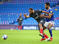 26th December 2020; Cardiff City Stadium, Cardiff, Glamorgan, Wales; English Football League Championship Football, Cardiff City versus Brentford; Bryan Mbeumo of Brentford is challenged by Curtis Nelson of Cardiff City