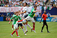 Brian Ching (11) of the United States (USA) and Jose Antonio Castro (15) of Mexico (MEX). Mexico (MEX) defeated the United States (USA) 5-0 during the finals of the CONCACAF Gold Cup at Giants Stadium in East Rutherford, NJ, on July 26, 2009.