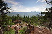Scenic view from the summit of Mount Tecumseh in Waterville Valley, New Hampshire during the summer months. If you are thinking the view looks better than you remember, its because someone has cut down a few trees.