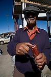 A man sells sausage on Rio do Rastro Mountain, Santa Catarina, Brazil