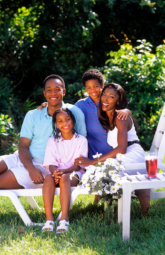 Black african american family outside at home relaxing with caring and love lifestyle