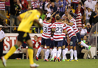 COLUMBUS, OHIO - SEPTEMBER 11, 2012:  Players of the USA MNT surround Herculez Gomez (9) after he had scored the game winning goal against  Jamaica during a CONCACAF 2014 World Cup qualifying  match at Crew Stadium, in Columbus, Ohio on September 11. USA won 1-0.