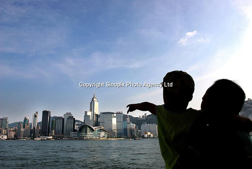 A generic shot of Hong Kong harbor view - Hong Kong side (Wan Chai area, Hong Kong Convention and Exhibition Center).