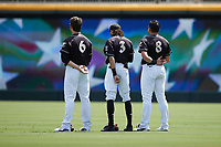 (L-R) Charlotte Knights outfielders Blake Rutherford (6), Billy Hamilton (3), and Mikie Mahtook (8) stand for the National Anthem prior to the game against the Durham Bulls at Truist Field on August 28, 2021 in Charlotte, North Carolina. (Brian Westerholt/Four Seam Images)