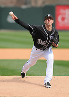 RHP Elliott Warford (30) of the Furman University Paladins pitches in a game against the Northwestern Wildcats on Saturday, February 16, 2013, at Fluor Field in Greenville, South Carolina. The game was cancelled in the fifth inning due to snow. (Tom Priddy/Four Seam Images)