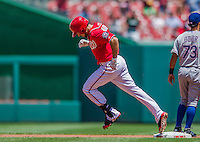 31 May 2014: Washington Nationals infielder Anthony Rendon rounds second after hitting a solo home run in the first inning against the Texas Rangers at Nationals Park in Washington, DC. The Nationals defeated the Rangers 10-2 to notch their second win of the 3-game inter-league series. Mandatory Credit: Ed Wolfstein Photo *** RAW (NEF) Image File Available ***
