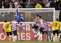 COLUMBUS, OHIO - SEPTEMBER 11, 2012:  Tim Howard (1) of the USA MNT punches away from Adrian Mariappa (19) of  Jamaica during a CONCACAF 2014 World Cup qualifying  match at Crew Stadium, in Columbus, Ohio on September 11. USA won 1-0.