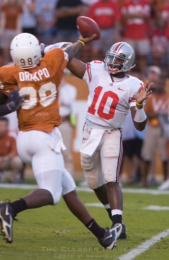 09 September 2006: Ohio State quarterback Troy Smith (#10) throws a pass under pressure from Texas defender Brian Orakpo during the  Buckeyes 24-7 victory over the Longhorns at Darrell K Royal Memorial Stadium in Austin, TX.
