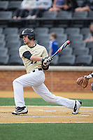 Bruce Steel (17) of the Wake Forest Demon Deacons follows through on his swing against the Georgia Tech Yellow Jackets at David F. Couch Ballpark on March 26, 2017 in  Winston-Salem, North Carolina.  The Demon Deacons defeated the Yellow Jackets 8-4.  (Brian Westerholt/Four Seam Images)