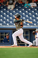 Nashville Sounds shortstop Franklin Barreto (9) follows through on a swing during a game against the New Orleans Baby Cakes on April 30, 2017 at First Tennessee Park in Nashville, Tennessee.  The game was postponed due to inclement weather in the fourth inning.  (Mike Janes/Four Seam Images)