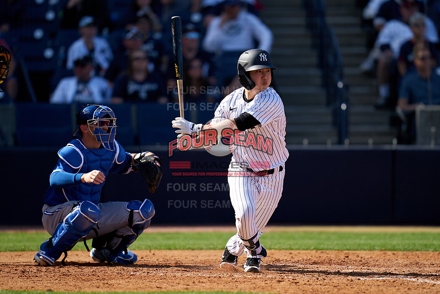 New York Yankees Hoy Jun Park bats in front of catcher Caleb Joseph (7) during a Spring Training game against the Toronto Blue Jays on February 22, 2020 at the George M. Steinbrenner Field in Tampa, Florida.  (Mike Janes/Four Seam Images)