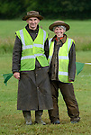 Well dressed volunteers  David and Dana-Leigh Pile helping to run the wet Dunsfold Collection weekend. Dunsfold Collection of Land Rovers Open Day 2011, Dunsfold, Surrey, UK. --- No releases available.