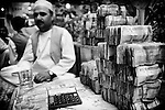 Money traders are seen in the Herat Currency Exchange 22 September 2013. Iranian rials are exchanged openly for US dollars and there are accusations that the Exchange is a centre of money laundering and may be contravening US sanctions against Iran (John D McHugh)