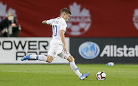 TORONTO, ON - OCTOBER 15: Christian Pulisic #10 of the United States sends a ball downfield during a game between Canada and USMNT at BMO Field on October 15, 2019 in Toronto, Canada.