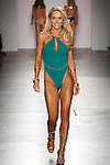Model walks runway in an outfit from the Yandy Swim 2017 collection on February 14, 2017; at Pier59 Studios during New York Fashion Week Fall Winter 2017.