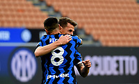 Inter Milan's Andrea Pinamonti, right, is hugged by his teammate Matias Vecino after scoring during the Italian Serie A football match between Inter Milan and Sampdoria at Milan's Giuseppe Meazza stadium, May 8, 2021.<br /> UPDATE IMAGES PRESS/Isabella Bonotto