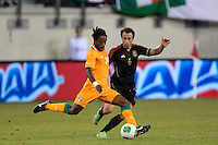 Ivory Coast midfielder Jean-Jaques Gosso (14) is marked by Mexico midfielder Gerardo Torrado (6). Mexico defeated the Ivory Coast 4-1 during an international friendly at MetLife Stadium in East Rutherford, NJ, on August 14, 2013.