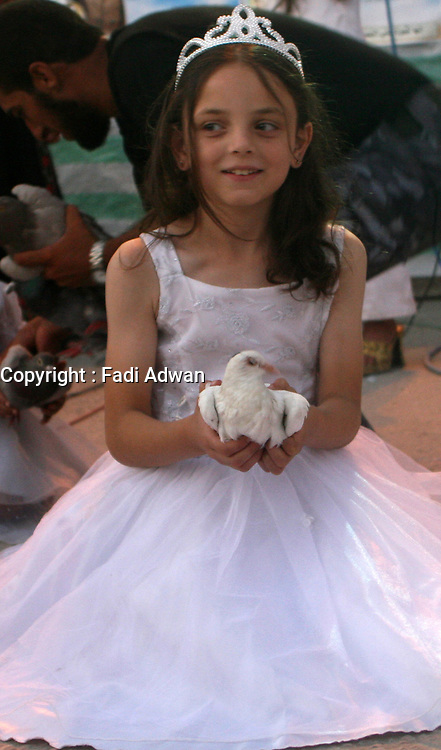 """Palestinians girl attend a rally help by Fatah Al Yasser movement in Gaza City, Tuesday, Aug. 7, 2007.""""photo by Fady Adwan"""""""
