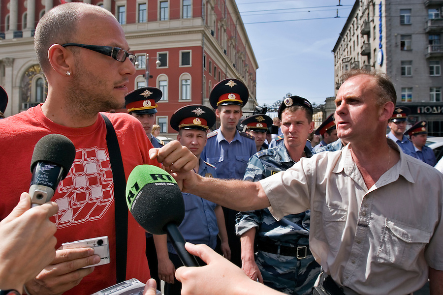 Moscow, Russia, 27/05/2007..Russian police look on as a nationalist demonstrator attacks a foreign delegate at Moscow's second attempted Gay Pride parade. The parade had already been banned by Moscow Mayor Yuri Luzhkov on the grounds that it would provoke violence, but gay activists attempted to demonstrate in defiance of the ban, and many were beaten by counter demonstrators and arrested by police.