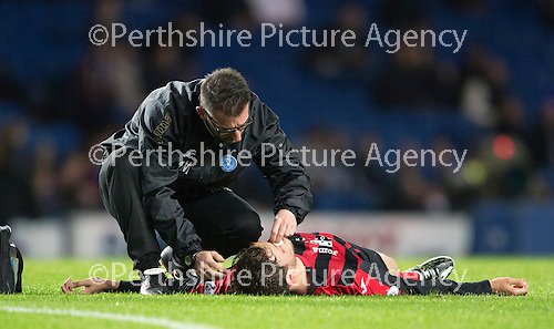 Rangers v St Johnstone....28.10.14   Scottish League Cup Quarter Final at Ibrox<br /> A concussed Murray Davidson is treated by physio Michael McBride<br /> Picture by Graeme Hart.<br /> Copyright Perthshire Picture Agency<br /> Tel: 01738 623350  Mobile: 07990 594431