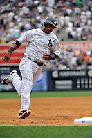 New York Yankees infielder Robinson Cano #24 during a game against the Texas Rangers at Yankee Stadium on June 16, 2011 in Bronx, NY.  Yankees defeated Rangers 3-2.  Tomasso DeRosa/Four Seam Images